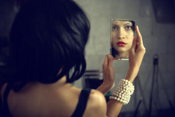 woman-looking-herself-in-mirror