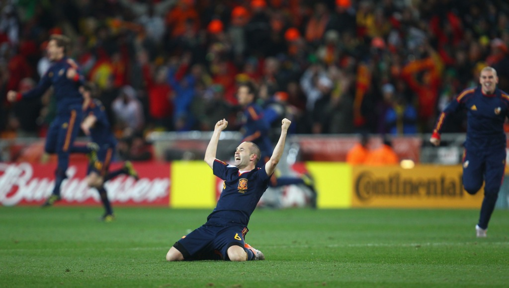 JOHANNESBURG, SOUTH AFRICA - JULY 11:  Andres Iniesta of Spain celebrates after his goal wins the World Cup for Spain during the 2010 FIFA World Cup South Africa Final match between Netherlands and Spain at Soccer City Stadium on July 11, 2010 in Johannesburg, South Africa.  (Photo by Lars Baron/Getty Images) *** Local Caption *** Andres Iniesta