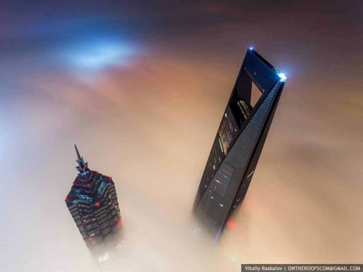 the-stunt-took-them-a-total-of-20-hours-since-they-entered-the-tower-at-night-scaled-the-crane-during-daybreak-and-waited-for-the-light-to-rise-to-capture-dream-like-views-of-the-neighboring-jin