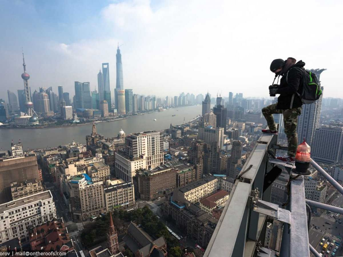 they-even-climbed-billboards-to-get-overarching-shots-of-shanghais-seaport-and-its-array-of-skyscrapers
