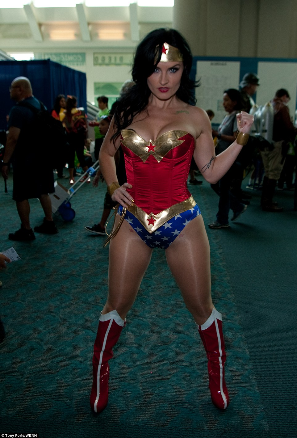 2A64E71200000578-3157610-Dressed_up_One_of_the_Wonder_Woman_who_attended_the_opening_day_-a-70_1436643026441