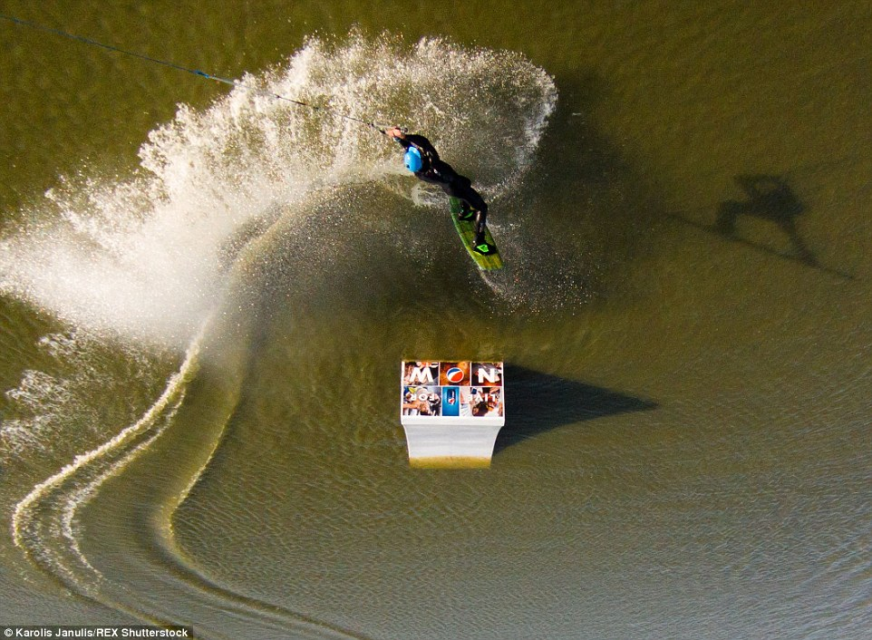 2ACC5ADB00000578-3173355-Thrillseeking_adventures_A_wakeboarder_doing_some_tricks_in_a_wi-a-46_1437748383342