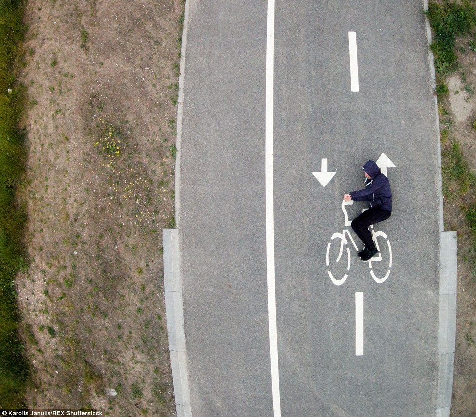 2ACC5B9A00000578-3173355-A_guy_pretending_to_driving_a_bicycle_painted_on_the_street_in_L-a-40_1437748383336
