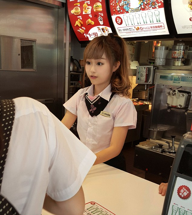 "Pic shows: Woman Hsu Wei-han working at the front counter of a McDonald's restaurant. A young woman working at the front counter of a McDonald's restaurant has become the latest overnight celebrity of working-class folk after she was discovered by a blogger. The woman known as Hsu Wei-han, whose age was not given, was spotted working at a McDonald's restaurant in the city of Kaohsiung, in southern Taiwan, by an avid blogger known as RainDog. RainDog noted on his blog that Wei-han, who is also known as ""Weiwei"" or ""Haitun"" (""dolphin"" in Chinese), was cute and wore a pink shirt and heels. His blog post rocketed Weiwei to Internet fame almost overnight. She has been called the ""cutest McDonald's goddess in Taiwanese history"", after netizens pointed out that McDonald's chains in the country were actually famous for dressing up their female employees in cute themed outfits, such as sailors or maids. Netizens in Kaohsiung are now scrambling to find out which branch she works at in hopes of getting a peek at the McDonald's Goddess. Other popular working-class beauties and ""hunks"" from Taiwan included fruit, tofu, and cake vendors in capital Taipei, as well as a girl who became known affectionately as the ""Pork Princess"". Some people however accused the blogger of manipulating the pictures and claiming the woman did not exist, even though several local media outlets republished the images of the girl with abnormally large eyes and doll-like features as a news story with no suggestion she was not real. (ends)"