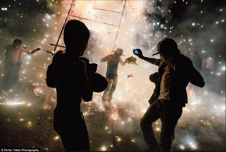 2D04A5B400000578-3257757-Men_amid_a_shower_of_sparks_from_fireworks_at_the_National_Pyrot-a-98_1443800119421