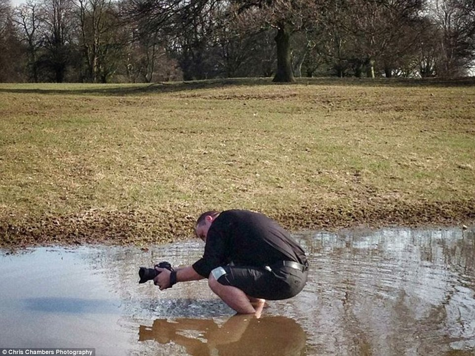 2D51B4F200000578-3266802-Chris_ankle_deep_in_muddy_water_to_create_the_perfect_shot-a-4_1444645617546