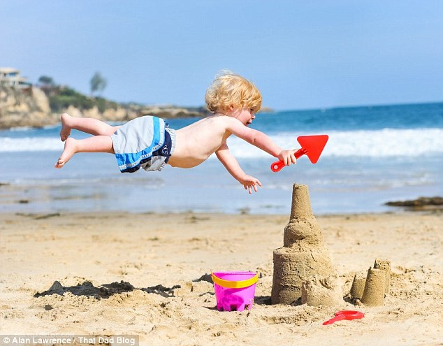 2D5FDAAF00000578-3271148-Beach_bum_The_adorable_child_builds_a_sandcastle_and_soars_over_-a-67_1444768500116