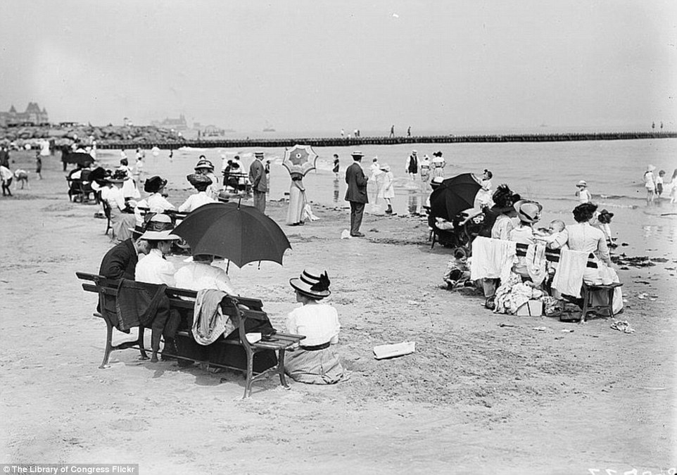 2DA0E14700000578-3282754-Scenes_on_Coney_Island_show_women_relaxing_with_parasols_and_lon-a-39_1445587040683