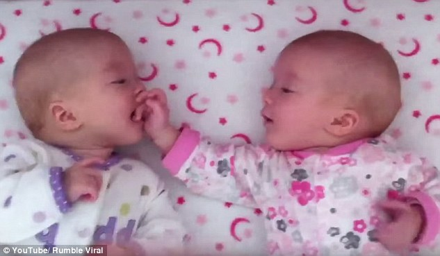 2DA5C73400000578-3283906-This_heartwarming_video_shows_the_identical_twin_sisters_happily-a-21_1445478112451