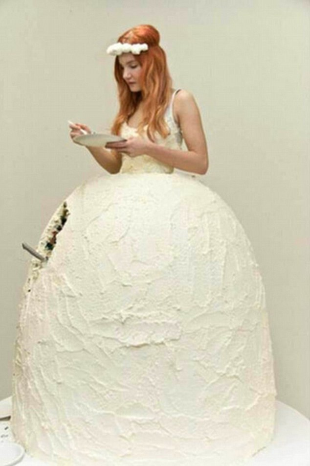 2DE1C8D800000578-3288431-One_flame_haired_bride_shows_off_an_outfit_made_out_of_a_giant_c-m-24_1446215839692