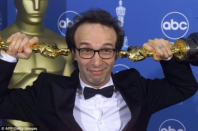 3101E31600000578-3437766-Italian_actor_director_Roberto_Benigni_stole_the_show_with_his_e-a-84_1455293397794