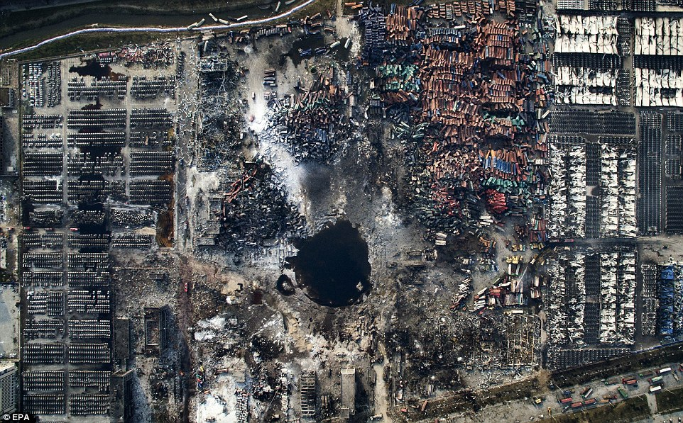 3157151300000578-3452659-The_picture_shows_an_aerial_view_of_the_destruction_after_the_ex-a-2_1455813038305