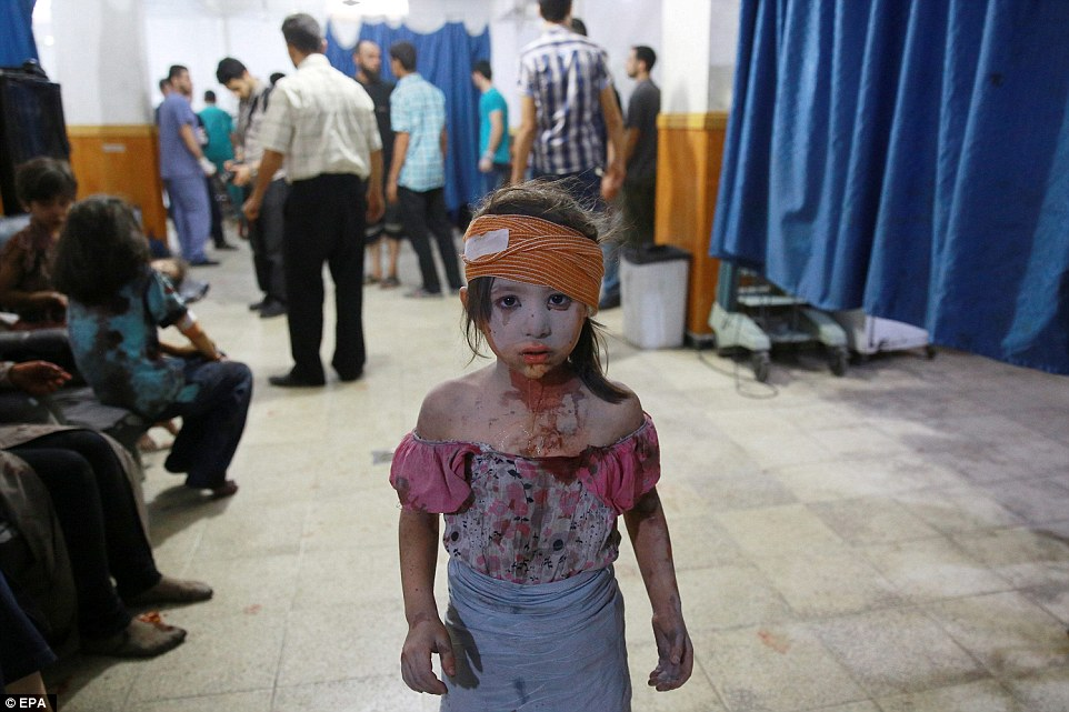 31571EC600000578-3452659-The_picture_shows_a_wounded_Syrian_girl_looking_on_at_a_make_shi-a-15_1455813038679