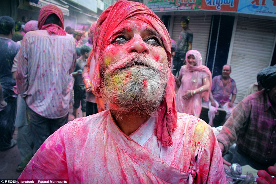 317126FC00000578-3458257-A_man_covered_in_colourful_powder_during_the_Holi_celebrations_i-a-84_1456147873915
