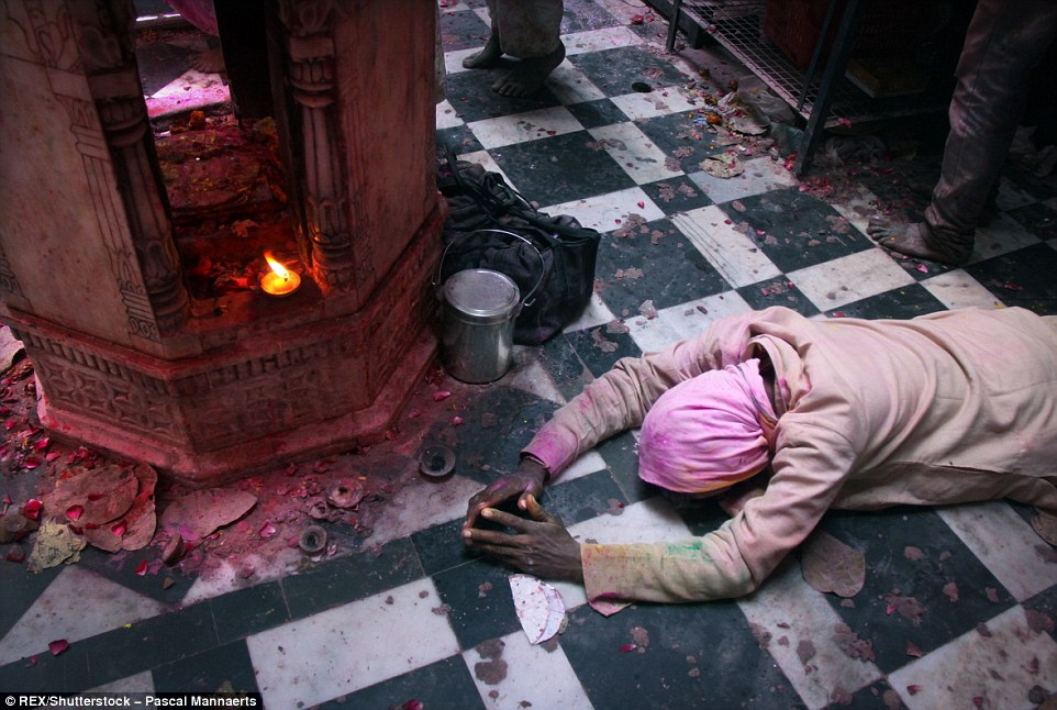3171271100000578-3458257-A_man_gives_prayer_at_the_Banke_Bihari_temple_Originally_Holi_wa-a-96_1456147926853