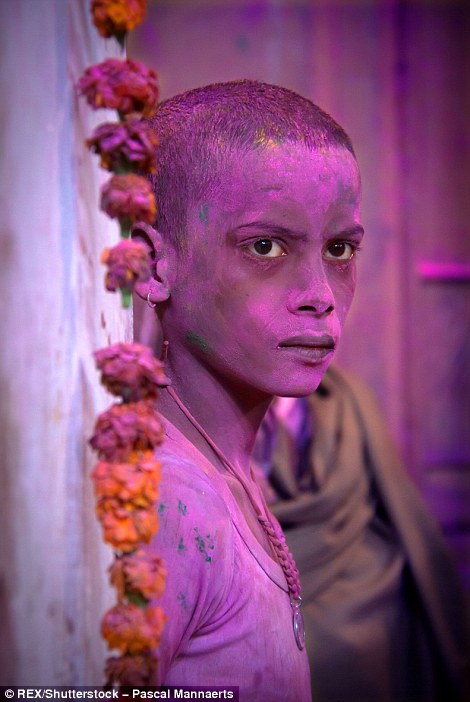 317127B400000578-3458257-A_portrait_of_Meera_Sahbaghini_covered_in_pink_powder_as_part_of-a-93_1456147898344