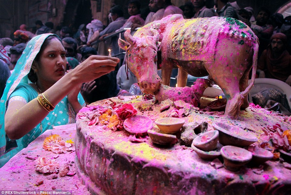 3171283400000578-3458257-A_woman_lights_a_candle_at_Banke_Bihari_temple_one_of_the_places-a-89_1456147886182