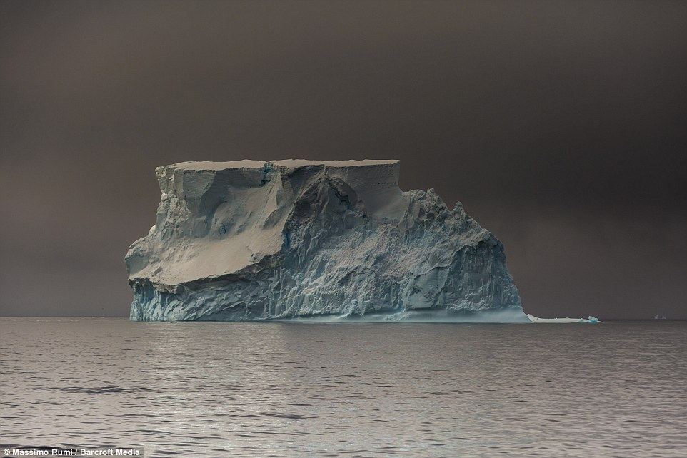 318AD47000000578-3463605-A_giant_lone_iceberg_floating_in_the_Antarctic_ocean_with_electr-a-4_1456408286297