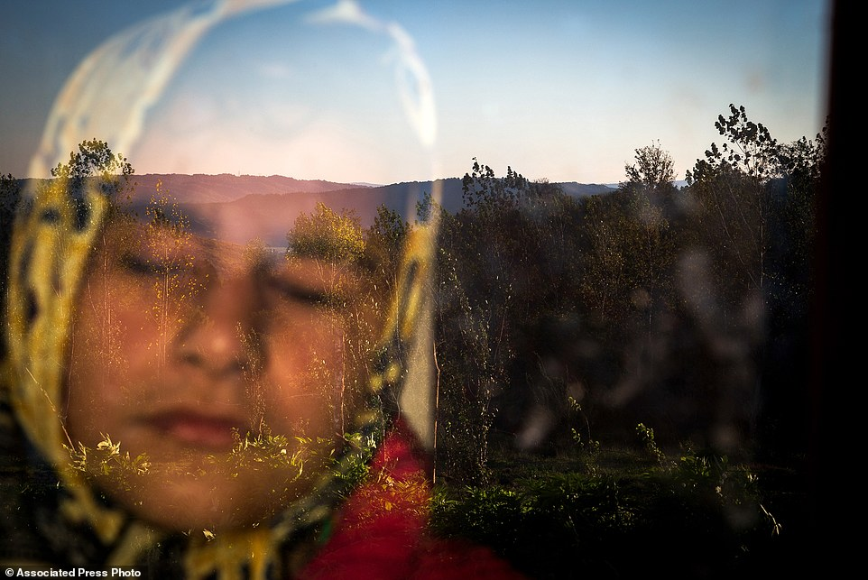 "In this image released by World Press Photo titled ""Into the Light"" by photographer Zohreh Saberi which won the third prize in the Daily Life Singles category shows Raheleh, who was born blind, standing behind the window in the morning. She likes the warmness of the sunlight on her face. Babol, Mazandaran, Iran, Nov. 12, 2015. (Zohren Saberi/Mehrnews Agency, World Press Photo via AP)"